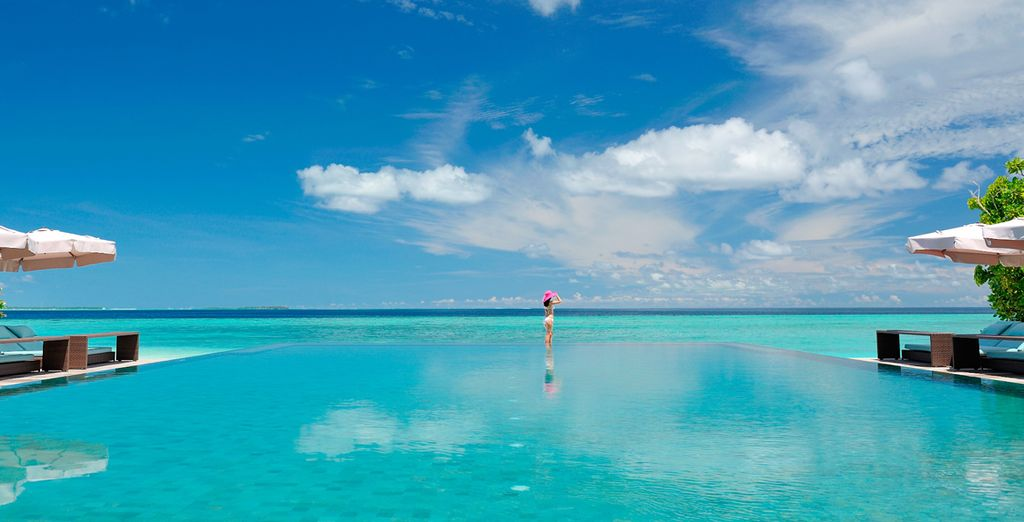 Cool off in the sparkling infinity pool blending into the sky