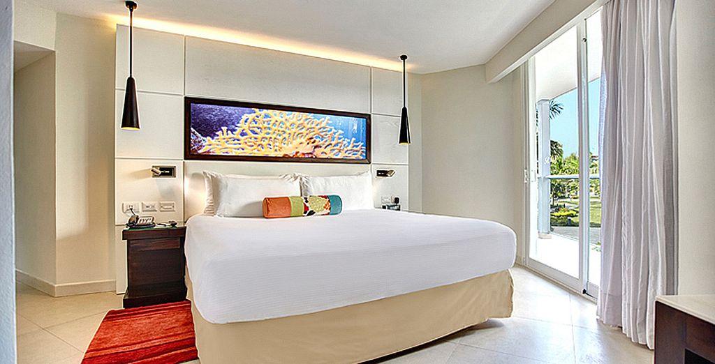 Te alojarás en una habitación Deluxe con Vistas al Océano