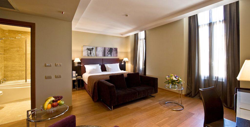 Descanse en una exclusiva habitación con terraza