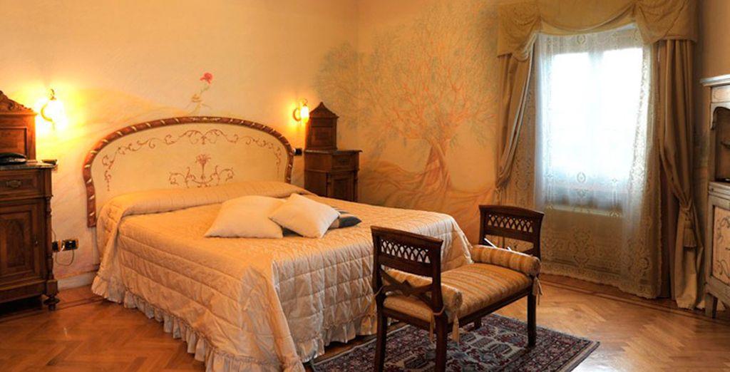 Descanse en una de las 8 habitaciones clásicas