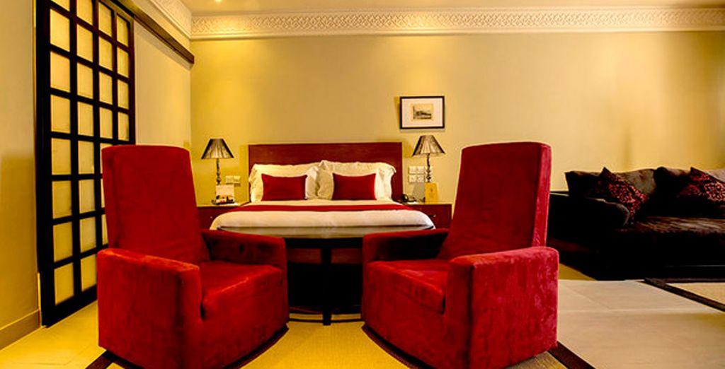 Tu habitación Deluxe te espera para ofrecerte un descanso perfecto