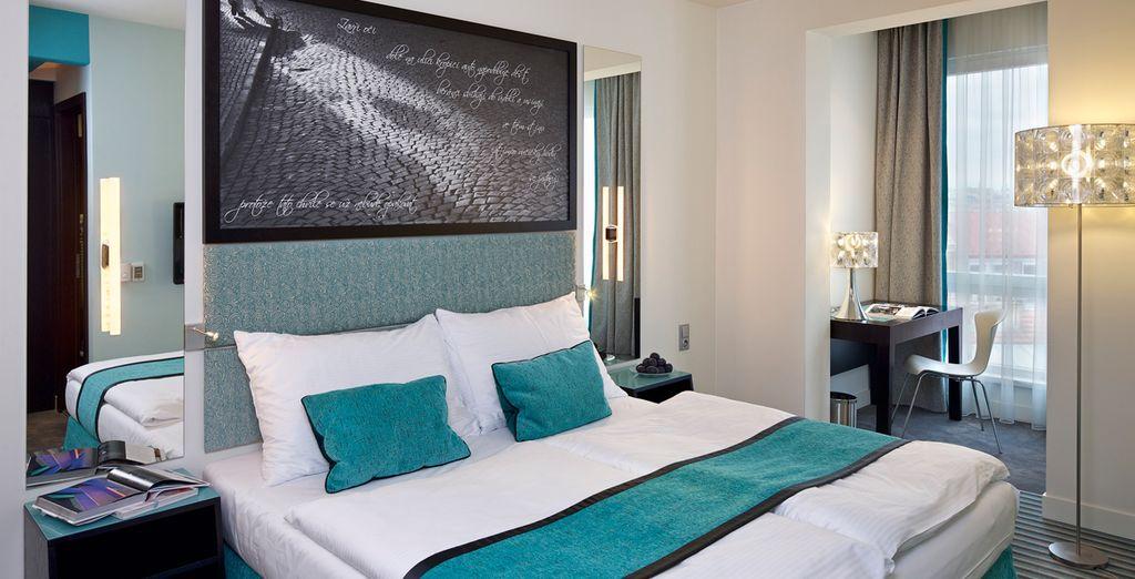 Tu habitación Executive decorada con tonos azules...