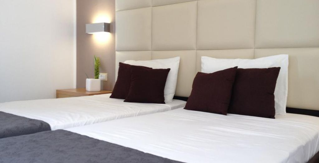 Descanse en espacios de estilo sencillo y armónico. Se sentirá como en casa