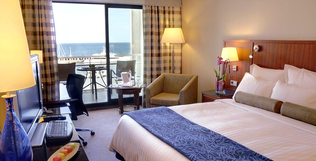 Prenez place dans votre chambre avec vue sur la mer