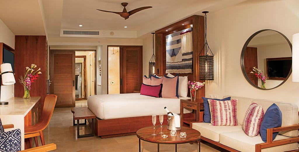 Et vivrez un séjour idyllique en Junior Suite Tropical View ou en Preferred Junior Suite Tropical View