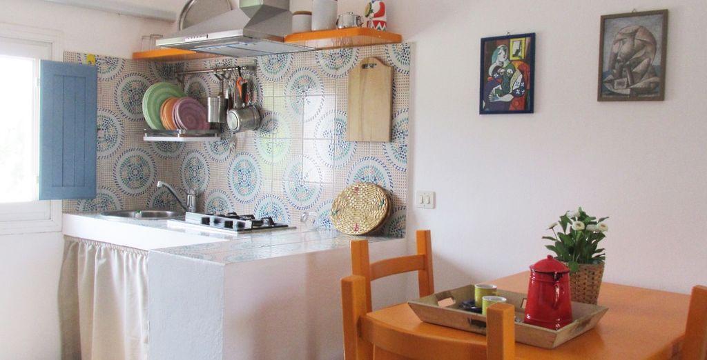 e una cucina attrezzata di tutto il necessario