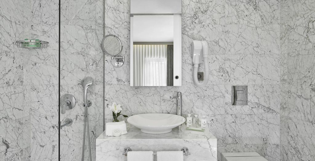 With its beautiful marble bathroom