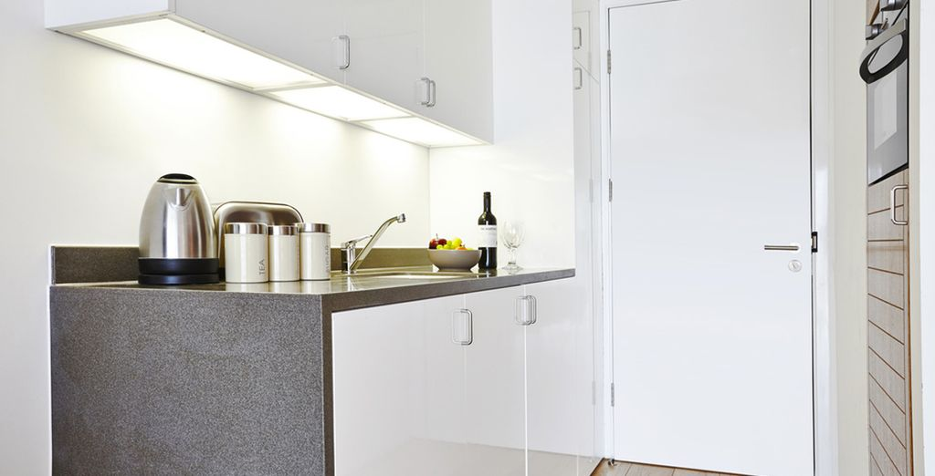Including a fully equipped kitchenette with minimalist design