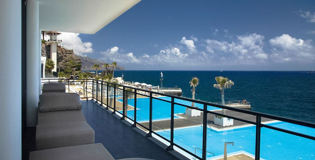 Located on a hillside overlooking the sparkling ocean...