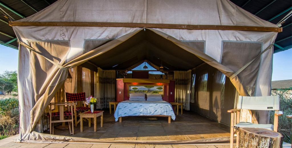 You will stay in authentic lodges and tented camps (Amboseli pictured)