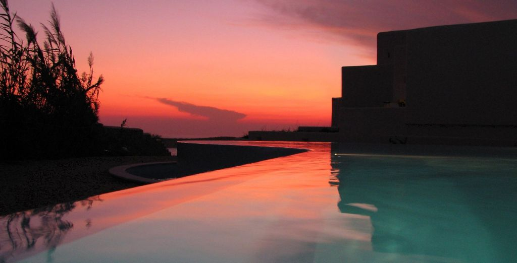 With a front row seat to Greece's famously beautiful sunsets (pictured: Archipelagos Hotel)