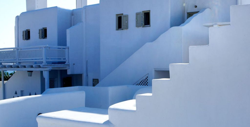 Admire the white-washed architecture of the hotel, reflecting the style of Mykonos