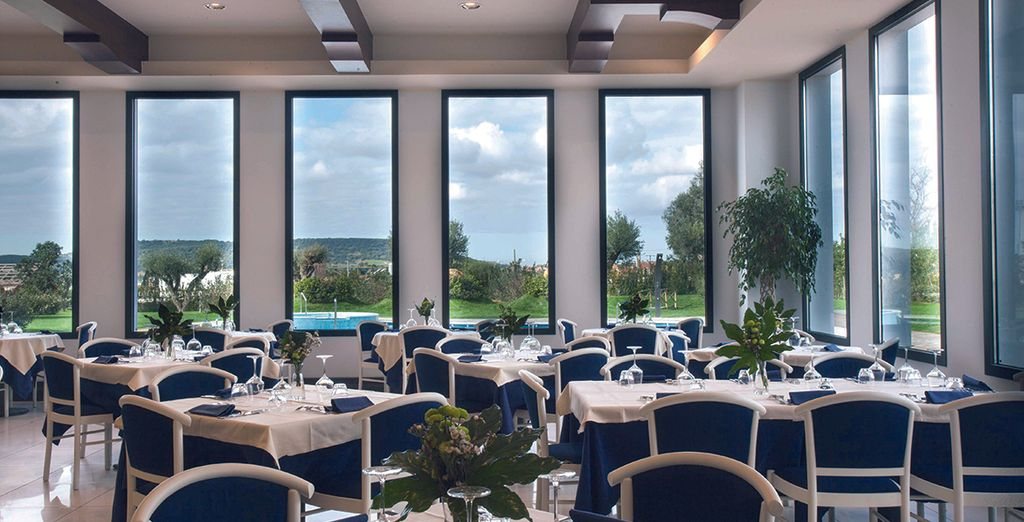 Eat delicious meals in the hotel restaurant's sophisticated setting