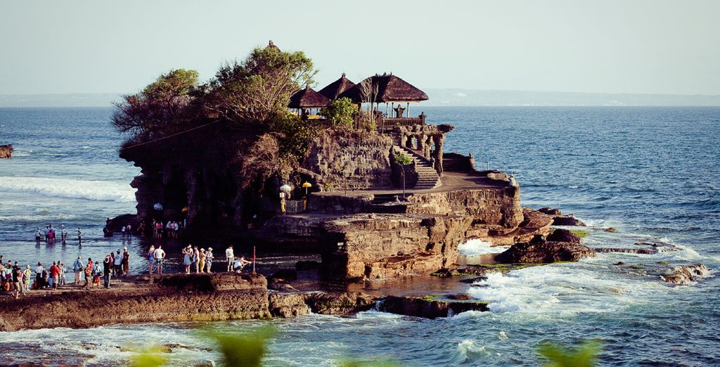 Visit nearby Tanah Lot, home to a pilgrimage temple