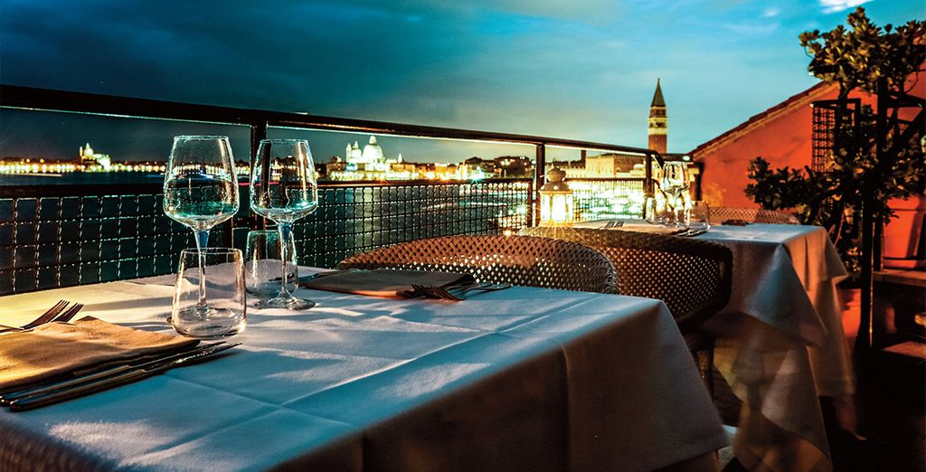 Sip a glass of wine on the terrace overlooking the lagoon