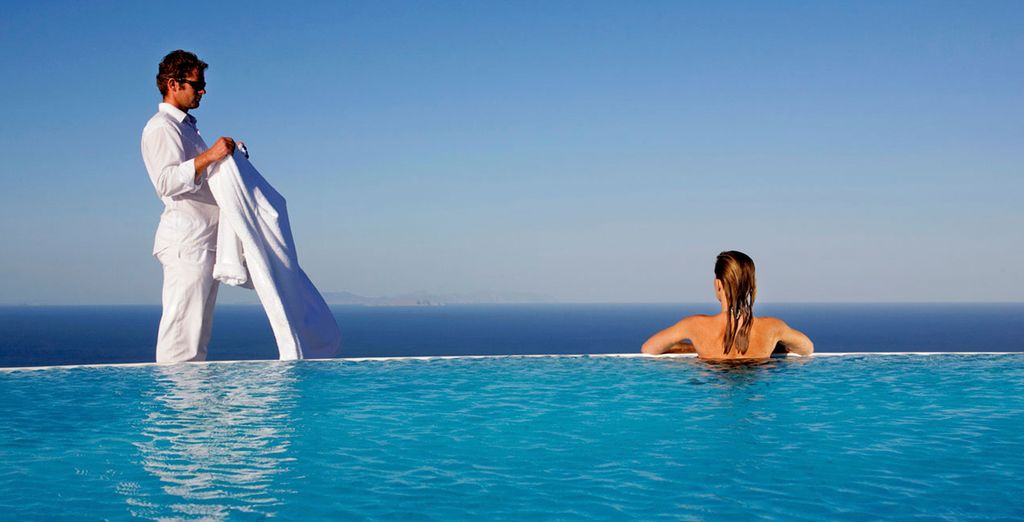 Or cool off in the pool with the endless Aegean Sea ahead