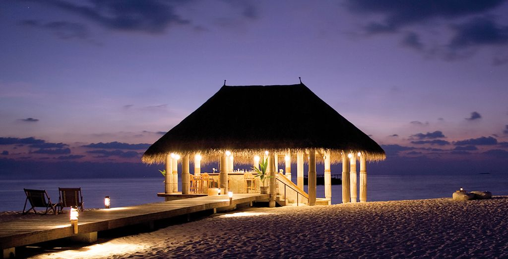 Or treat yourself to a private dinner on a moonlit beach...