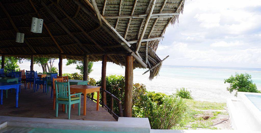 The restaurant overlooks the glittering ocean
