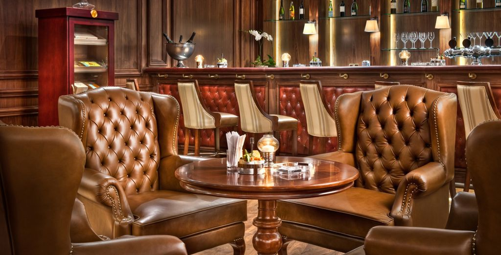 Order a drink in the richly decorated bar