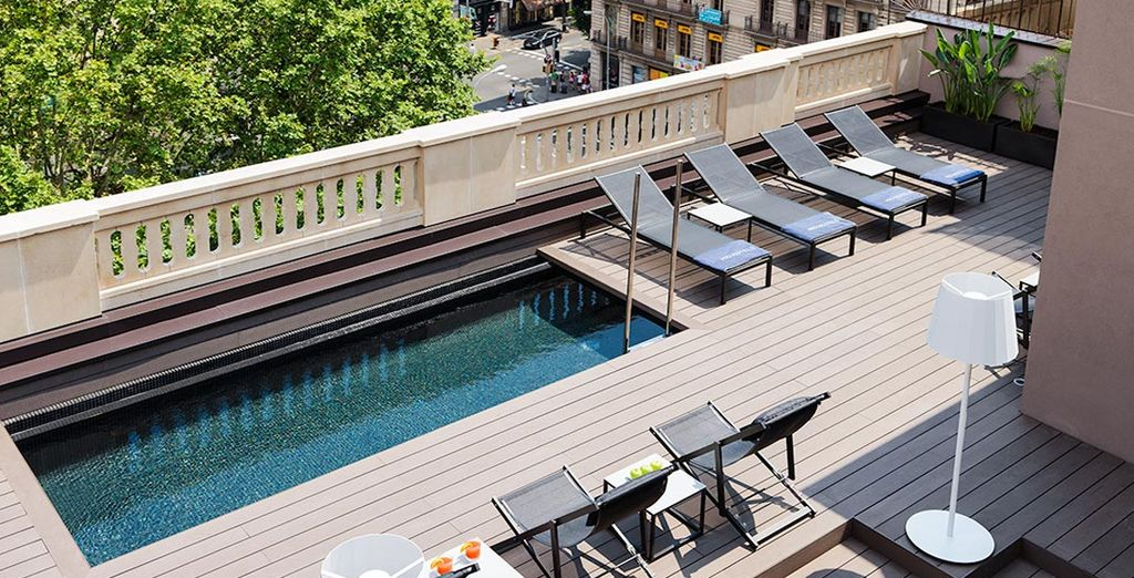 If the weather is warm, head to the hotel's pool after sightseeing