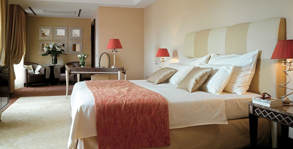Settle into your Superior Room with a complimentary bottle of wine