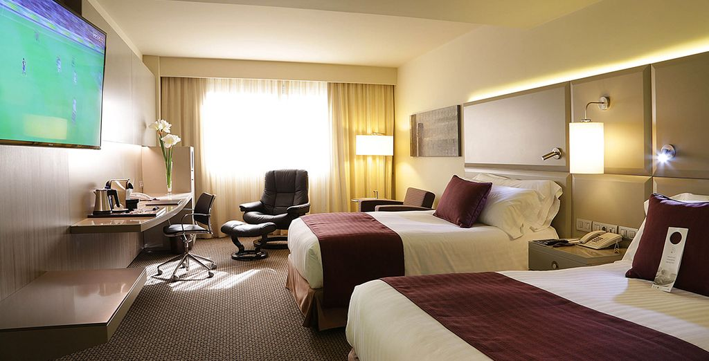 Settle into your spacious Deluxe Room