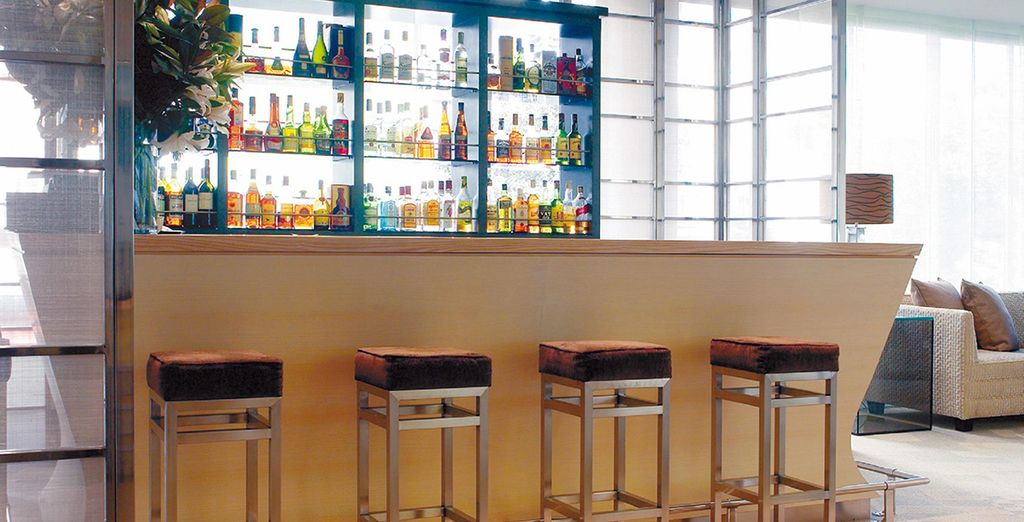 Enjoy a drink at the stylish bar