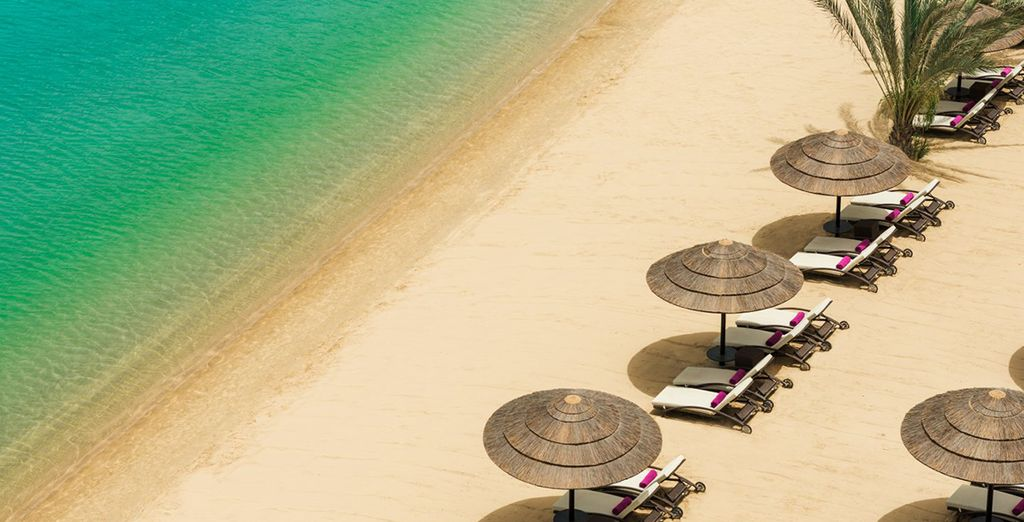 Head down to the private beach to soak up the sun