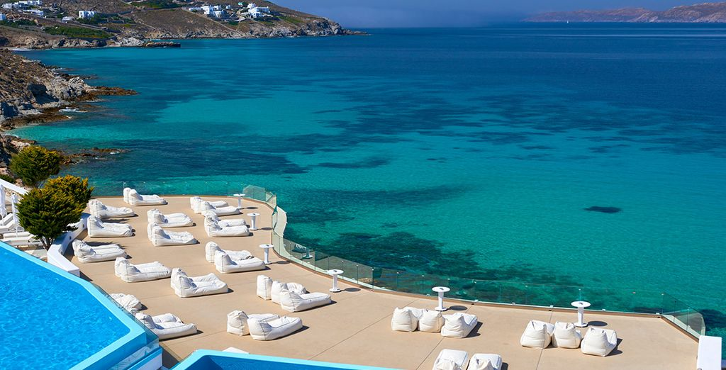 Lined with plush sun loungers facing the clear waters