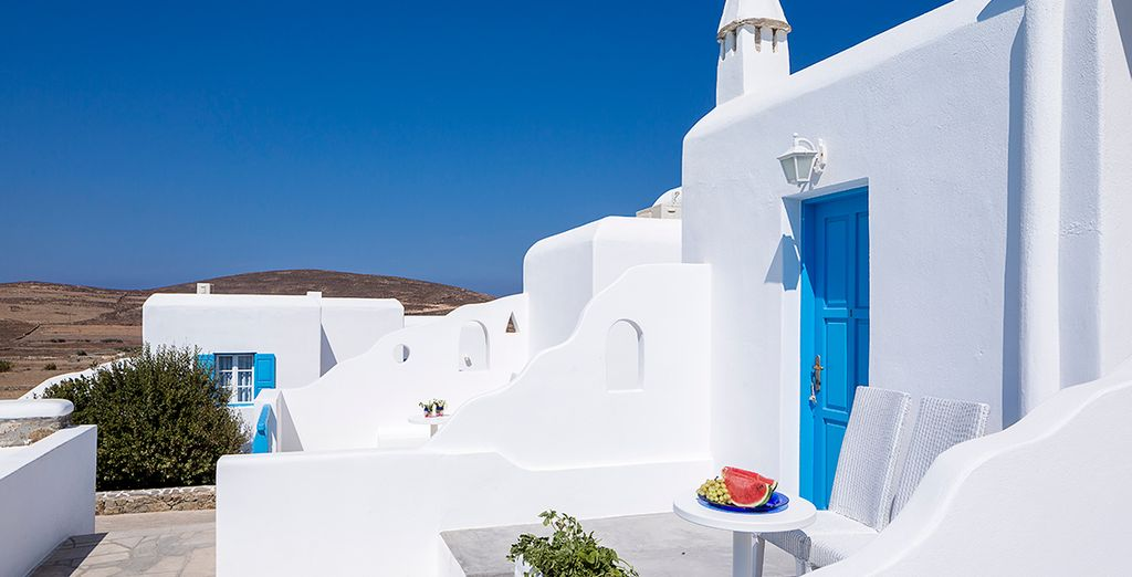 Where traditional whitewashed walls and a rustic design...
