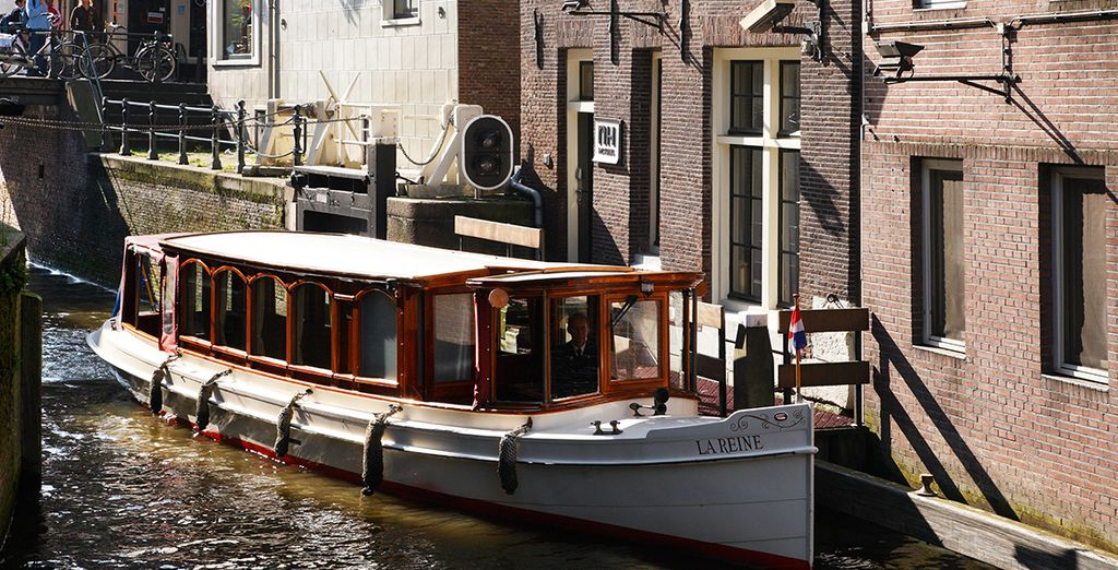 Hop on a canal boat from the hotel's private dock!