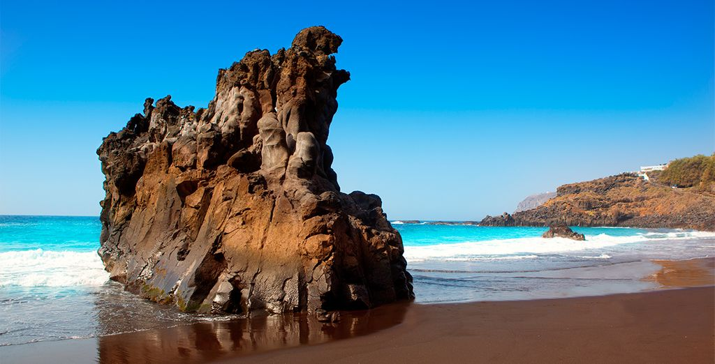 The volcanic sand beaches and turquoise sea...