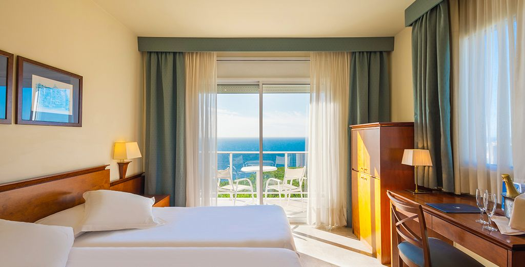 Your upgraded room offers sweeping views of the sea
