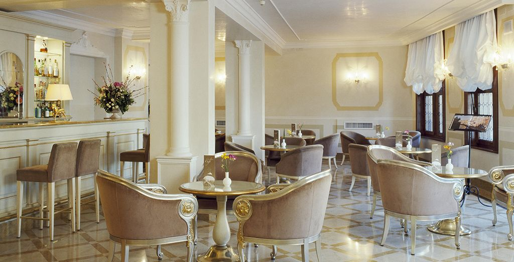Return to the hotel for an aperitif