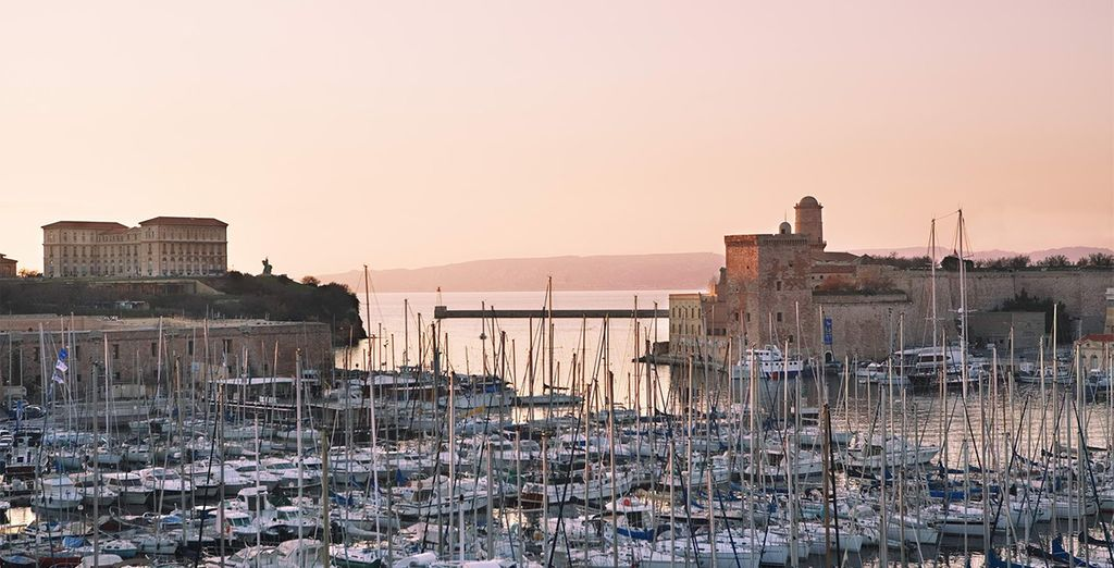 Stroll along its charming harbour