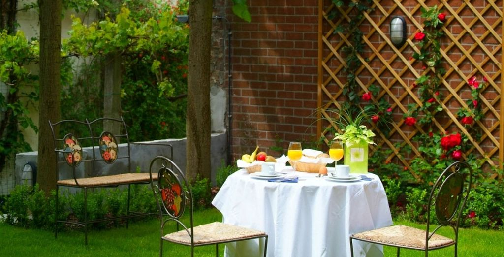 If the sun is shining, take afternoon tea in the hotel's garden on your return