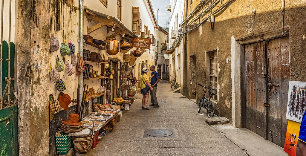 or visit the Stone Town (optional excursion)