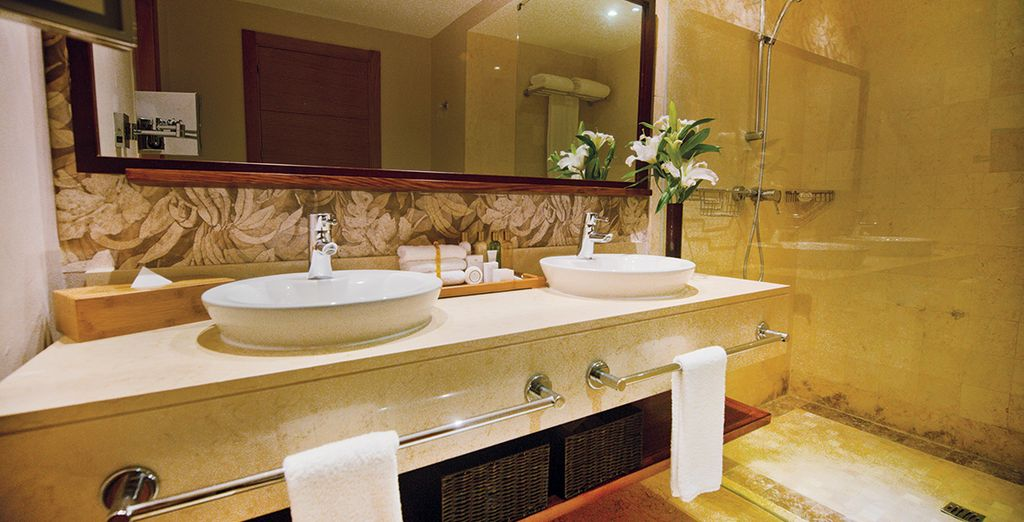 With an elegant bathroom fitted in gleaming marble