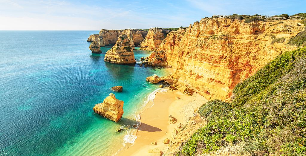 Hire a car and explore the Algarve's numerous beautiful beaches