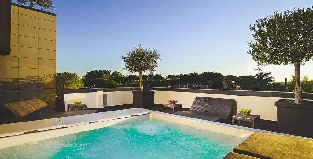 Book a session in the roof terrace hot tub