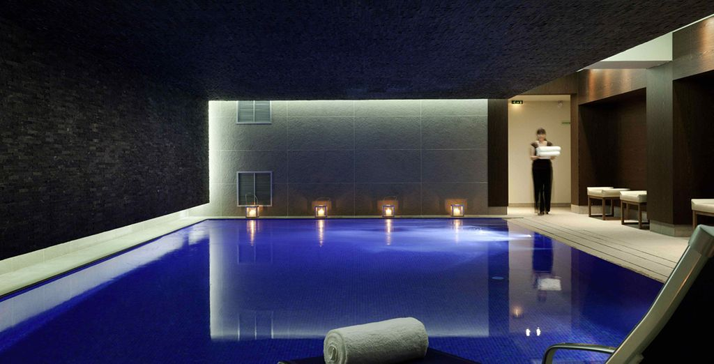 Unwind by the candlelit pool