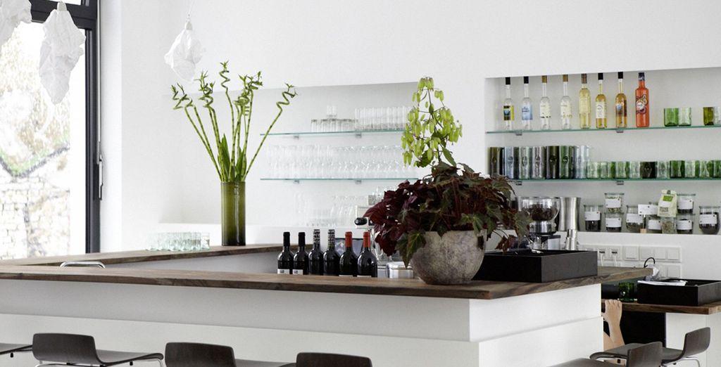 Order a drink at the minimalist bar