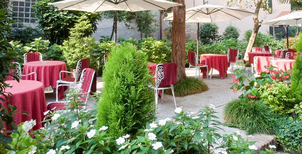 Sip a drink in the hotel's tranquil garden