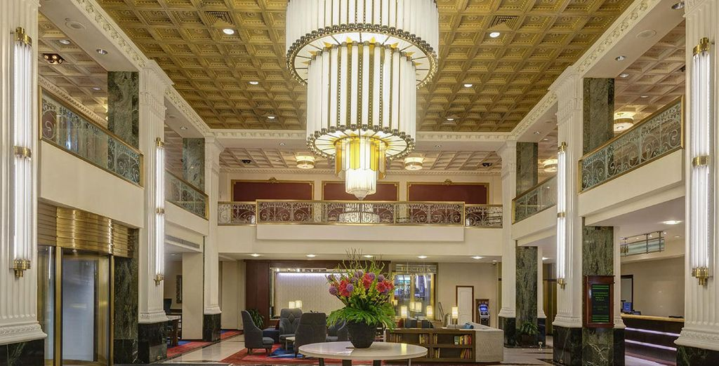 Stay at Wyndham New Yorker, a hotel built in 1929, during the height of the Jazz Age