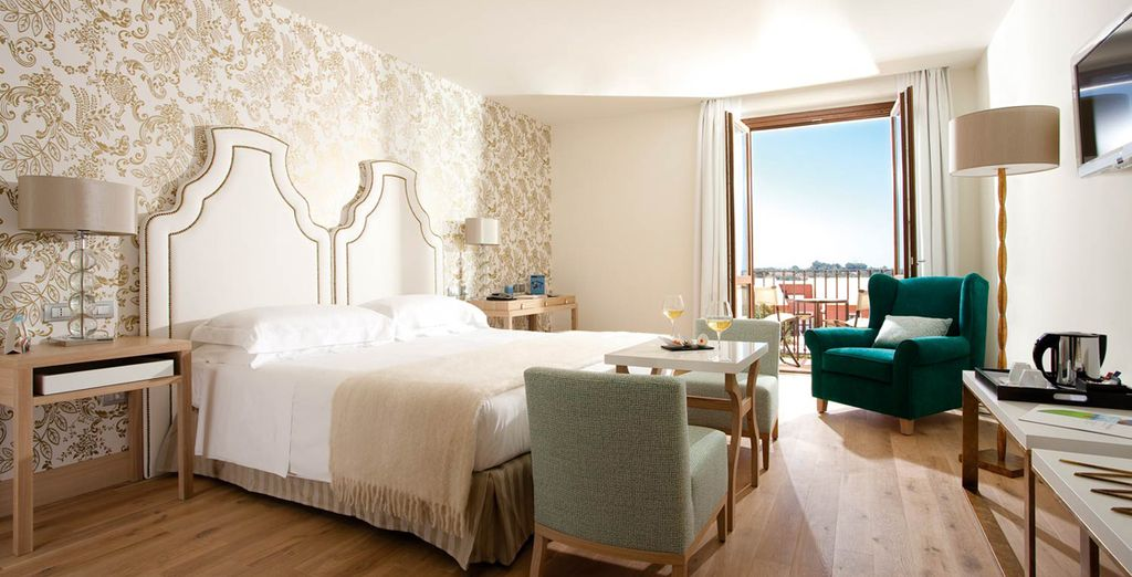 Enjoy a stay in a spacious Deluxe Room