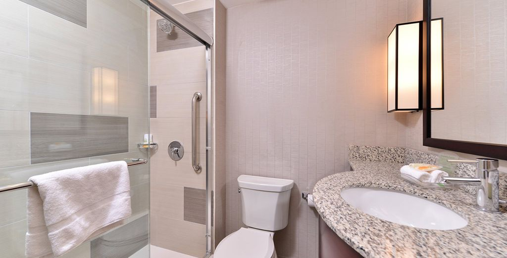 Featuring a sleek and well-equipped bathroom