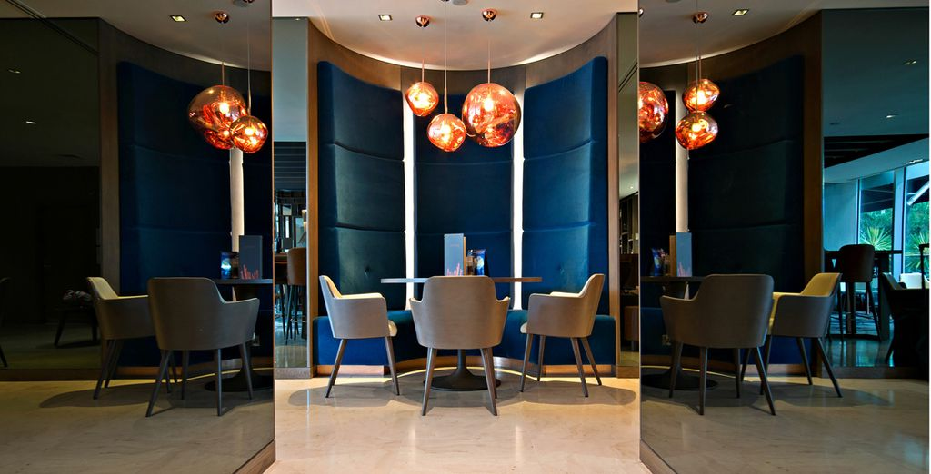 Return to the hotel for a cocktail in the stylish bar