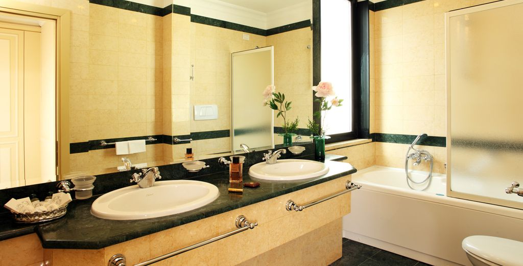 Your marbled bathroom in your Classic Room exudes elegance