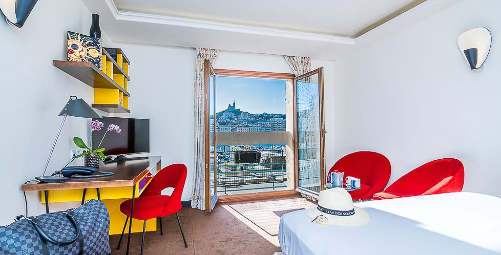 Settle into the comfort of the Deluxe Room Sea View