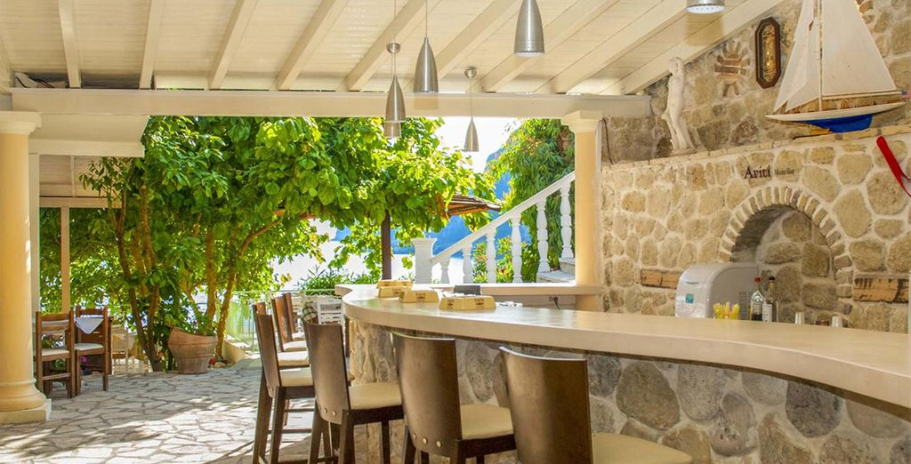 Indulge in the local Ouzo at the all-inclusive Ariti Bar